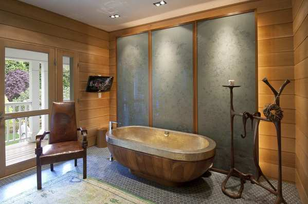 The master bathroom tub is made of hand-hammered brass.