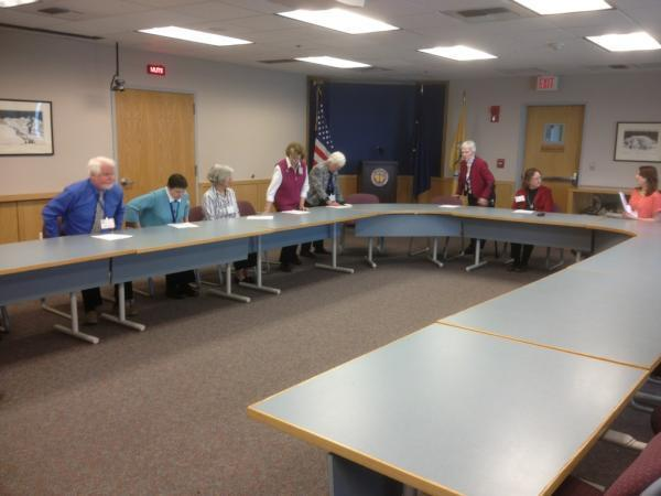 Members of Anchorage's Election Commission convened a canvassing meeting at 1:30 p.m. Tuesday and adjourned two minutes later -- but called themselves back into session to hear testimony from would-be voter Karli Kay, the only member of the public who showed up to testify.