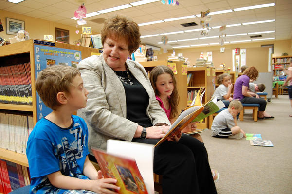 Waynesboro Area School District's newly hired superintendent, Sherian Diller, reads with first-graders Clay Gift and Jayden Shatzer earlier this week.