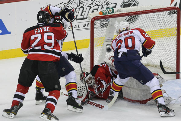 New Jersey Devils goalie Martin Brodeur (30) makes a save on Florida Panthers left wing Sean Bergenheim (20) during the first period of game three of the 2012 Eastern Conference quarterfinals at the Prudential Center.