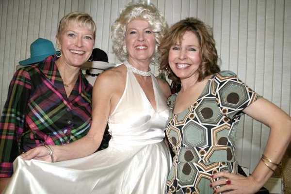 Supporting their Marilyn Monroe-themed fashion show are Womens Council members, from left, Event Co-Chairman Sue Wilder, Ruth McNevin as Marilyn and Event Chairman Jill Haines.