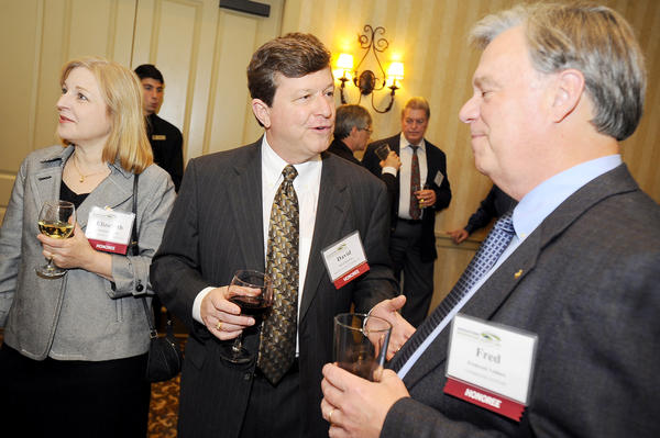 "David Beachley, center, president of Beachley Furniture Co. Inc., talks with Fred Vollmer, president of COMMLINK Systems during the Hagerstown-Washington County Economic Development Commission's annual ""Celebration of Business"" Tuesday at Fountain Head Country Club in Hagerstown. At left is David Beachley's wife, Elizabeth Beachley."