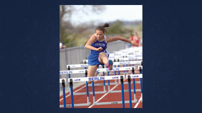 Berlin's Catelyn Hittie clears the last hurdle to win the 100 meter race with a time of 16.2 seconds.