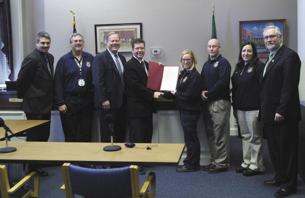 The Franklin County (Pa.) Commissioners recently paid tribute Tuesday to the 911 dispatchers in the countys department of emergency services.. Pictured from left are Ben Rice,Bryan Stevenson, Commissioner Robert Ziobrowski,Commissioner David Keller, Megan OBrien, Mike MCatee, Juliana Schrecenogost and Commissioner Robert Thomas.