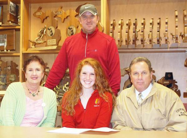 Petoskey senior Olivia Pizii (front, center) signs a national letter of intent to play golf at Ferris State University Tuesday at the Petoskey High School athletic office. Joining Pizii are her mother Janice (left), father Tony (right), and swing coach Brian ONeill (back), the director of instruction at Boyne Resorts.