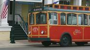 PETOSKEY — Petoskey Downtown Management Board members agreed Tuesday to spend $1 to buy a road trolley that could be used to offer rides to business district visitors in summer.