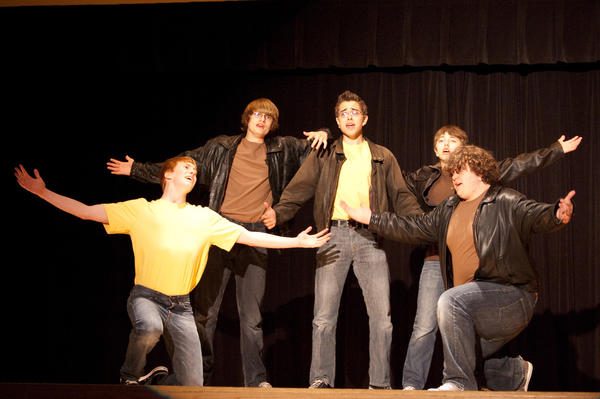 "Courtesy photo Members of the Jets gang, (from left) Nickolas McGeorge, Josiah Schmidt, Josh Meicher, Noah Jergenson and Trenton Sulak, sings ""When You're a Jet"" during a recent rehearsal of Concord Academy Boyne's ""West Side Story."" The show opens Friday, April 20, on the school stage."