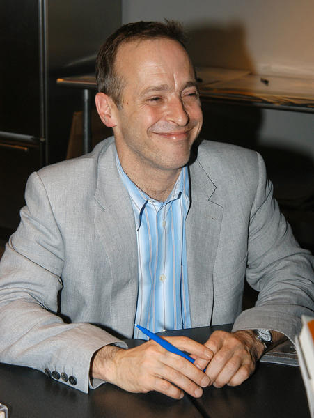 NEW YORK - JUNE 2: Author David Sedaris signs a book for a fan at the Symphony Space with David Sedaris presents selected shorts June 2, 2004 in New York City. (Photo by Bryan Bedder/Getty Images)
