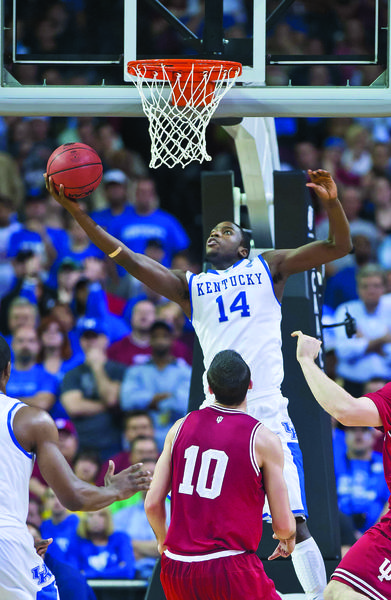 Kentucky forward Michael Kidd-Gilchrist (14) goes up for two in the first half in the NCAA tournament win over Indiana. Kidd-Gilchrist said he wanted to win the NCAA title for coach John Caliapri, and it was Calipari who made him ready to enter the NBA draft.