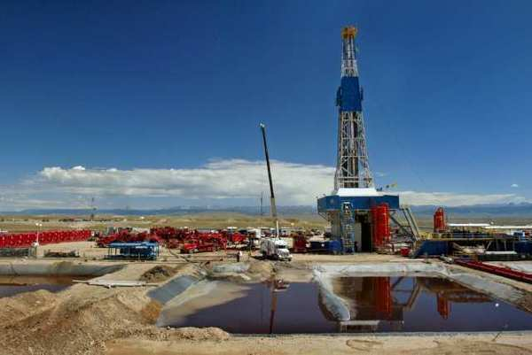 Halliburton Co. drilling a well using hydraulic fracturing in 2004. The company reported record revenue in North America even as natural gas production drops.