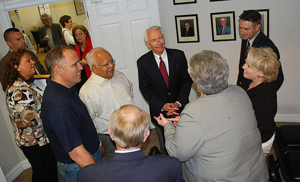 Gov. Steve Beshear talks to a Casey County contingent during a visit Tuesday to Liberty.
