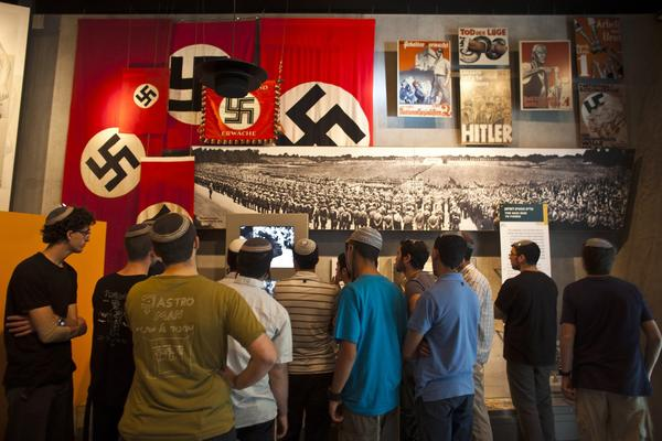Visitors look at an installation at Yad Vashem's Holocaust History Museum in Jerusalem April 18, 2012. Starting Wednesday evening, Israel marks the annual memorial day commemorating the six million Jews killed by the Nazis in the Holocaust.
