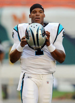 Cam Newton of the Carolina Panthers prepares to start a preseason game against the Miami Dolphins. Miami Dolphins vs. Carolina Panthers. Sun Life Stadium, Miami Gardens, FL.