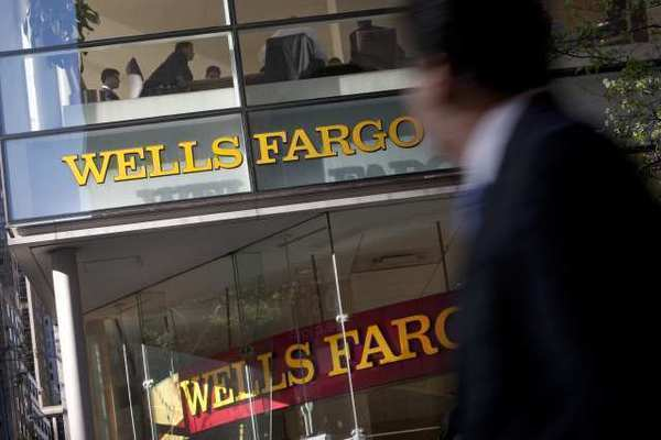 Wells Fargo & Co. is one of the lenders that authorities have accused of discriminatory lending. A consumer watchdog agency said Wednesday that it plans to crack down on the practice.
