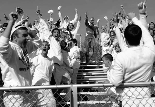 "Lake Zurich students, dressed all in white, celebrate during their school's upset win over Glenbard West during <a class=""taxInlineTagLink"" id=""ORSPT000539"" title=""Illinois High School Association"" href=""/topic/sports/high-school-sports/illinois-high-school-association-ORSPT000539.topic"">IHSA</a> Class 7A football playoff game in Glen Ellyn, Illinois."