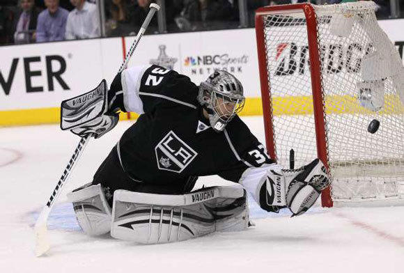 Jonathan Quick of the Kings knocks away a shot by the Vancouver Canucks in Game 3.