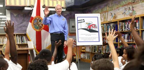 Gov. Rick Scott teaches a lesson on how a bill becomes a law, during a bill-signing ceremony for the state budget, at Tangelo Park Elementary school, in Orlando, Wednesday, April 18, 2012.