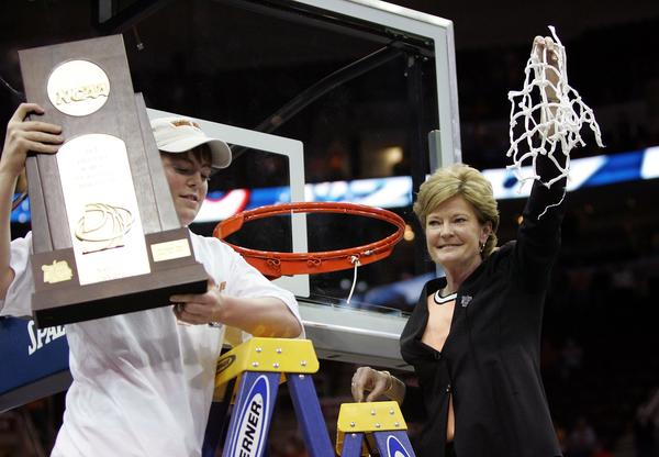 Pat Summitt of the Tennessee Lady Volunteers and her son Tyler celebrate after cutting down the net after Tennessee's 59-46 win against the Rutgers Scarlet Knights to win the 2007 NCAA Women's Basketball Championship