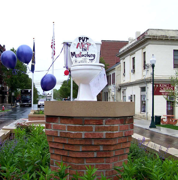 "A toilet with the words, ""Put Art in Martinsburg"" was placed on a pedestal in Martinsburg, W.Va.'s city square Wednesday morning. It was taken down about 30 minutes later."
