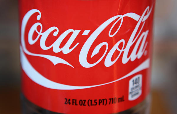 The Coca-Cola logo is printed on the lanel of a 24-ounce bottle of soda in Chicago, Illinois.