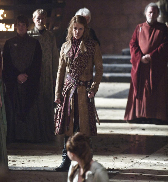 "Eugene Simon (center), who plays Lancel Lannister in ""Game of Thrones,"" said watching his co-star Jack Gleeson (King Joffrey) deliver his lines from this scene with so much malice was shocking and ""kind of awesome."""