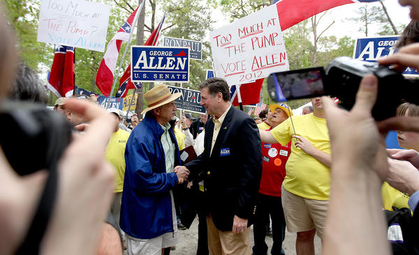 Former Virginia governor and senator George Allen works the crowd at the 2012 Shad Planking event in Wakefield Wednesday. Allen is currently locked in a tight race with former governor Tim Kaine for the U.S. Senate. George Allen was the main speaker for the event.