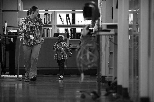 "Registered Nurse Amy Duscharme plays tag with Kya in the hallway at <a class=""taxInlineTagLink"" id=""PLCUL00021986"" title=""Rush University Medical Center"" href=""/topic/health/hospitals-clinics/rush-university-medical-center-PLCUL00021986.topic"">Rush University Medical Center</a> in Chicago."