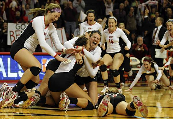 "Benet Academy celebrates as they defeat <a class=""taxInlineTagLink"" id=""PLGEO100100501230000"" title=""Cary"" href=""/topic/us/illinois/mchenry-county/cary-PLGEO100100501230000.topic"">Cary</a>-Grove in the 4A girls volleyball championship at Redbird Arena in Normal, Illinois."