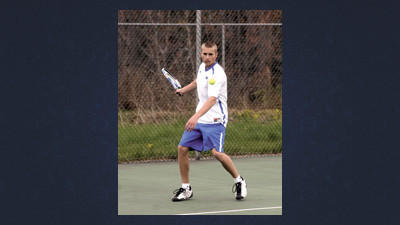 Windber's No. 1 singles player Stephen Thomas returns a Bishop Guilfoyle volley in a boys tennis match at Windber on Wednesday.