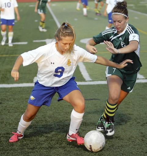 Aberdeen Central's Carly Hegge, left, tries to keep the ball from Pierre's Micah Palmer, right, during Thursday's game at Swisher Field. photo by john davis taken 9/8/2011