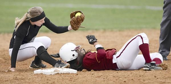 Northern State University's Caitlin Moran, right, came up short in her attempt to steal second base as she was tagged out by University of Minnesota-Duluth's Kierra Jeffers, left, during Wednesday's first game at the Moccasin Creek Softball Complex. photo by john davis taken 4/18/2012