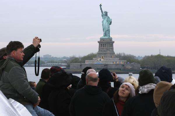 Passengers aboard the Titanic Memorial Cruise view the Statue of Liberty while arriving in New York April 19, 2012. The ship had sailed from Southampton, retracing the route of the ill fated Titanic.