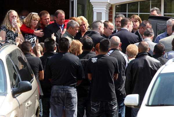 Family and friends look on as 12-year-old Eric Lederman's casket is brought out at Dieterle Memorial Home in Montgomery. Lederman died last week after being hit by a baseball.