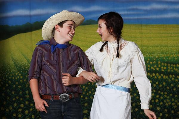 "Patrick Prunty plays Curly and Kaitlin McSwine plays Laurey Williams in ""Oklahoma,"" presented this weekend by Hagerstown Children's Theater."
