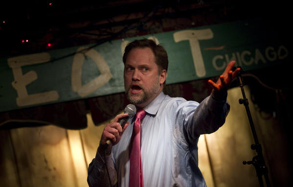 Host Ian Belknap makes introductions during Write Club at The Hideout bar.
