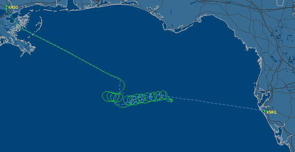 This radar image released by FlightAware.com shows the flight path (green line) of a Cessna 421 twin-engine plane over the Gulf of Mexico.