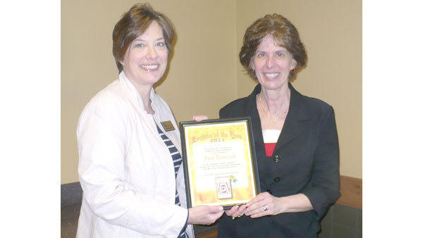 Anita Lawnichak (r) receives the 2011 Zontian of the Year Award for spearheading the club's soapmaking project, for always lending a helping hand and for her encouraging spirit. The award is presented by Cherie Nutter, president of The Zonta Club of Gaylord Area.