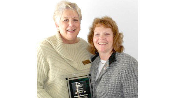 Teresa Koronka, accounting manager and assistant to the director (l), and Marilyn Kaczanowski, director, display the Gaylord Area Chamber of Commerces Chairmans Award received by the Friendship Housing Center.