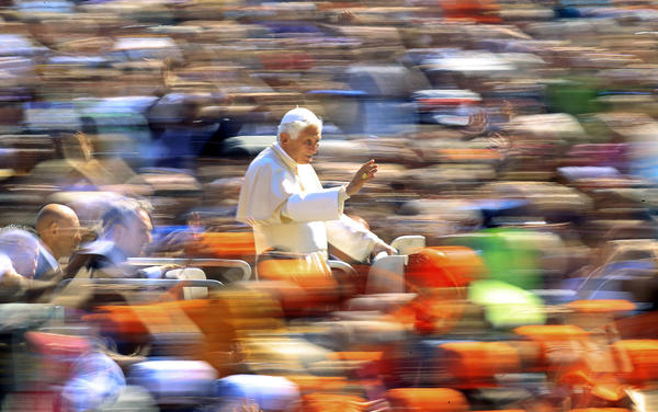 Pope Benedict XVI waves Wednesday as he arrives to lead the weekly general audience in Saint Peter's Square at the Vatican.