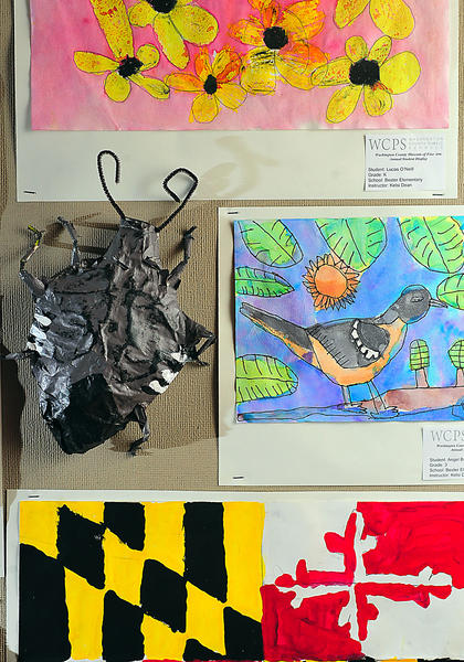 A stink bug sculpture crawls over other Bester Elementary School artwork at the Washington County Public Schools art show at Washington County Museum of Fine Arts.