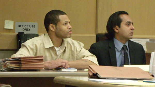 Ismael McCall, left, and defense attorney Utpal Dighe watch as testimony wraps up in McCall's first-degree murder trial Thursday. Jury deliberations resume Friday morning.