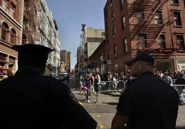 NYPD officers keep onlookers away from the search site on Prince Street.