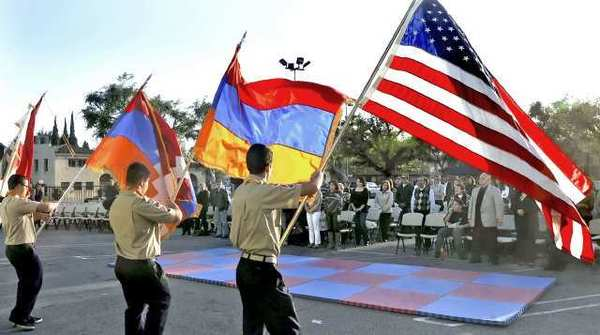 Members of the Homenetman Glendale Ararat Chapter Scouting Division honor guard present the American and Armenian, left of American, Flags while singing of both National Anthems. This was during the One Voice, One Cause event to commemorate the 97th anniversary of the Armenian Genocide at the St. Mary's Armenian Church in Glendale.