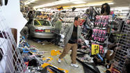 A 50-year-old woman was injured when a car crashed into a beauty supply store this afternoon on the West Side, officials said.