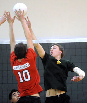 Parkland's Zachary Dolan (10) blocks a spike made by Emmaus's Jake Reynolds (2) in their boys volleyball game held at Emmaus High School on Thursday.