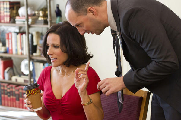 "Vice President Selena Meyer (Julia Louis-Dreyfus) and stop her aide, Gary (Tony Hale), as he tries to give her info in ""Veep."""
