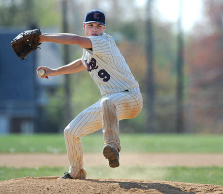Liberty's pitcher Jimmy McCarthy (9) delivers a pitch against Central Catholic High School Thursday afternoon.