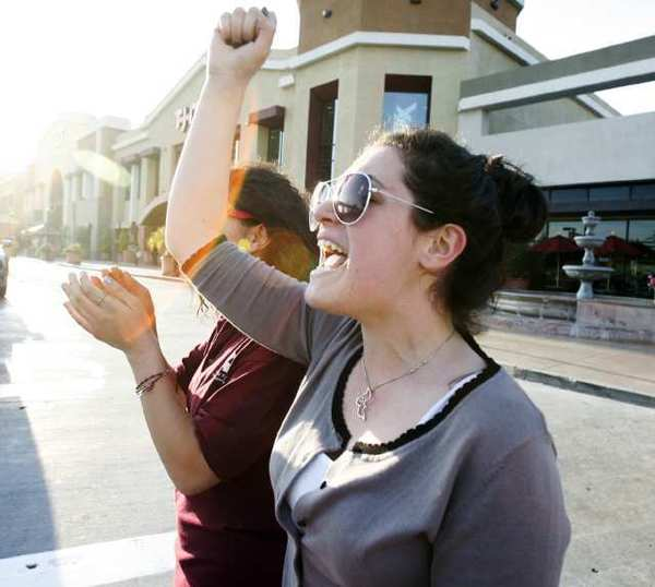 Suzanna Sargsyan, 19, chants '2, 4, 6, 8, we suppport the end of rape' as she marches along Glendale Avenue as part of a first-time event in Glendale called In Her Shoes to raise awareness to domestic violence and violence toward women.