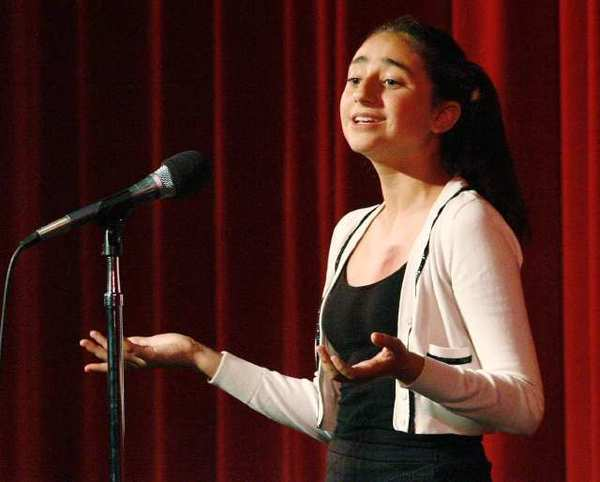 Anna Parsamyan, 13, of Woodrow Wilson Middle School, recites a poem at the 11th Annual Genocide Commemoration at Glendale High School.