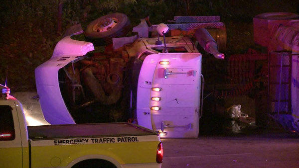 This dump truck rolled over and forced police to close the ramp from Interstate 290 to the Dan Ryan Expressway.